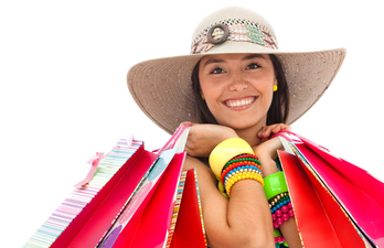 Smiling woman with shopping, delivered by e-commerce systems from Gotham Projets Ltd